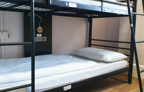 Dormitory bed in a hostel